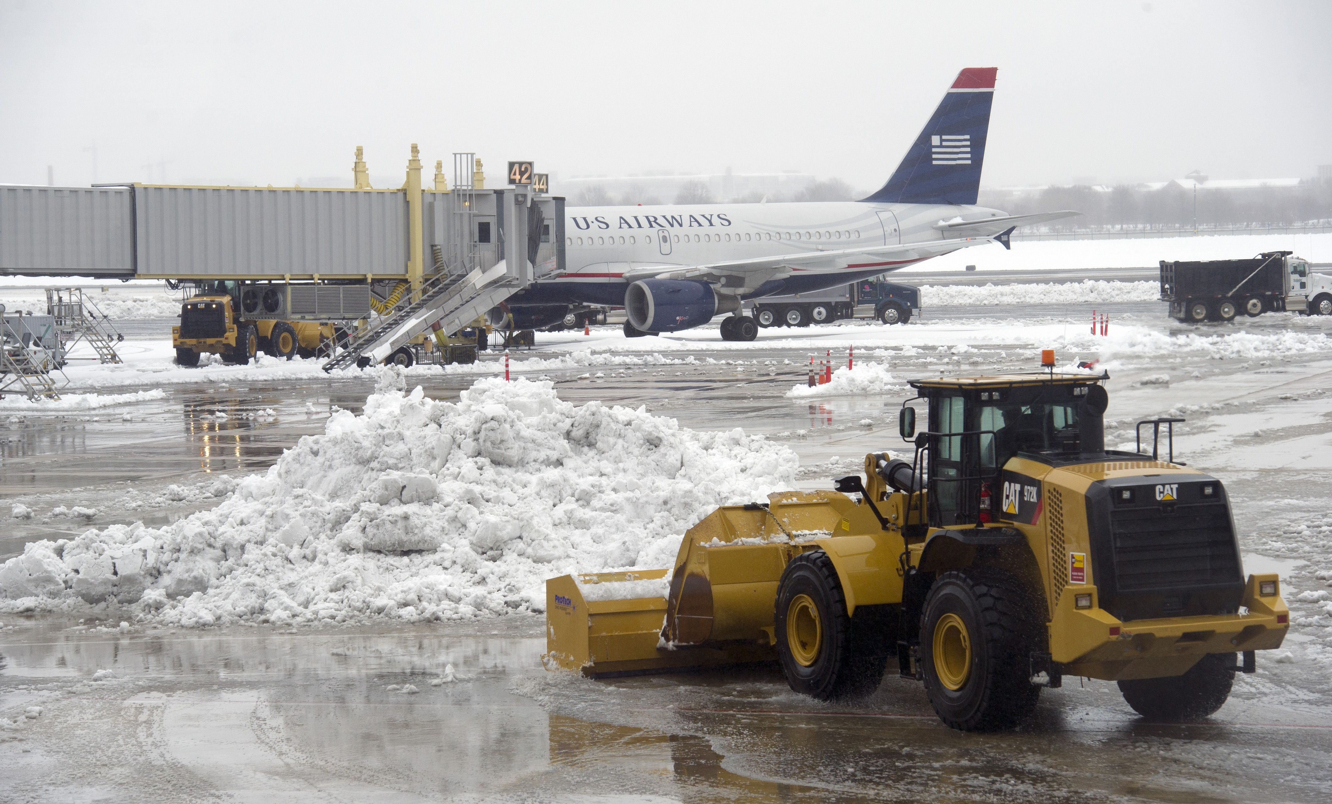 How are local airports taking on the snow?