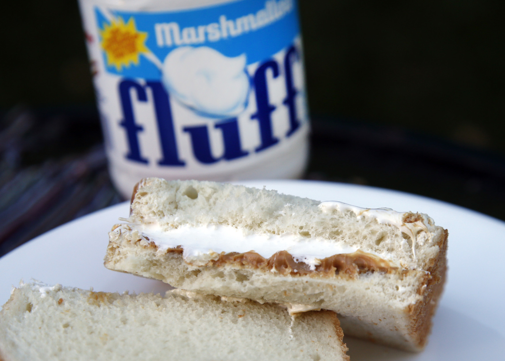 In this Sept. 27 2013 photo, a jar of Marshmallow Fluff and a Fluffernutter sandwich are displayed in North Andover, Mass. Last year, the company that makes Marshmallow Fluff sold about 8 million pounds of the white creme, and a bill to make the Fluffernutter _ peanut butter and Fluff on bread _ the official state sandwich has been reintroduced in the state legislature. (AP Photo/Elise Amendola)