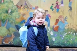In this handout photograph provided by Kensington Palace on Wednesday, Jan. 6, 2016, taken by Kate, The Duchess of Cambridge, Britain's  Prince George poses on his first day at the Westacre Montessori nursery school near Sandringham in Norfolk, England.  (The Duchess of Cambridge/Kensington Palace via AP)