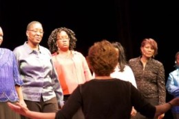 Deb Gottesman, co-director of The Theatre Lab School of the Dramatic Arts, instructing a Life Stories program with formerly homeless women in substance abuse recovery at N Street Village in Washington, D.C. (Courtesy Fuchsia Film)