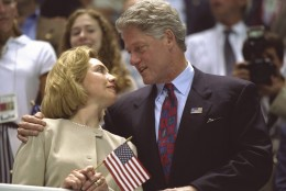 25 Jul 1996:  Hillary Clinton, left, and Bill Clinton look to one another as the USA women's 4x200m freestyle relay team wins the gold medal at the Georgia Tech Aquatic Center at the 1996 Centennial Olympic Games in Atlanta, Georgia.  Mandatory Credit: Simon Bruty  /Allsport