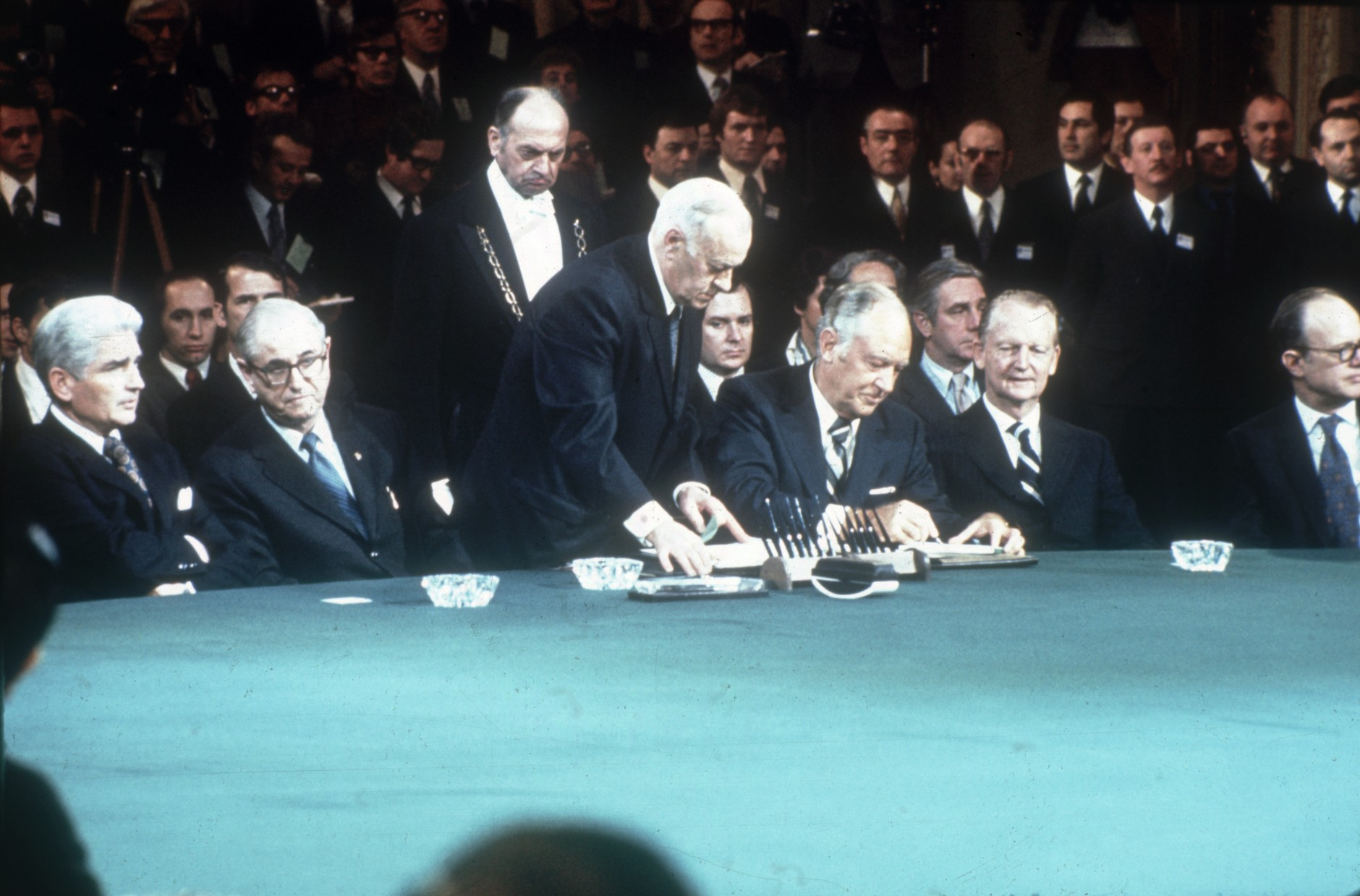 January 1973:  American Secretary of State, William Rogers (1969 - 1973), signing the Vietnam peace treaty in Paris. Also present to sign are Nguyen Duy Trinh, North Vietnam's minister of foreign affairs, the South Vietnamese foreign minister Tran Van Lam, American Secretary of State Henry Kissinger (1973 - 1974) and Vietnamese politician Le Duc Tho.  (Photo by Keystone/Getty Images)
