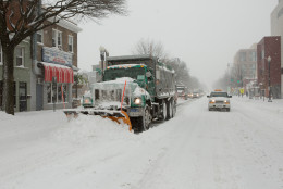 A phalanx of snow plows and city vehicles move north on Georgia Ave. in the Petworth neighborhood on January 23, 2016 in Washington, DC. Over a foot of snow has already fallen in the city in the past 24 hours, in what experts say could be a record-breaking storm. (Photo by Allison Shelley/Getty Images)