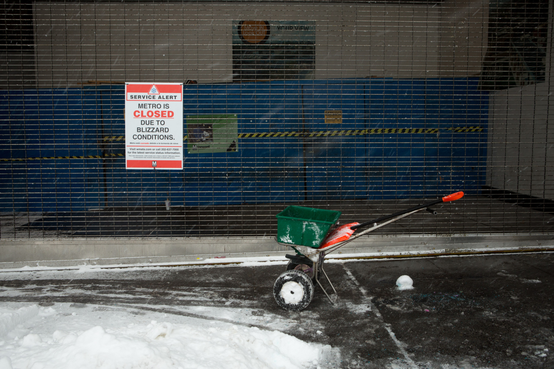 A salt spreader sits in front of the shuttered Georgia Ave.-Petworth metro station on January 23, 2016 in Washington, DC. Over a foot of snow has already fallen in the city in the past 24 hours, in what experts say could be a record-breaking storm.  (Photo by Allison Shelley/Getty Images)