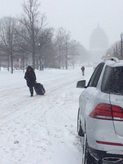 A woman is seen pulling a suitcase heading towards Union Station. (WTOP/Steve Dresner)