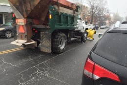 A snow plow heads down the road in Warrenton, Virginia on Friday, Jan. 22. (WTOP/Neal Augenstein)
