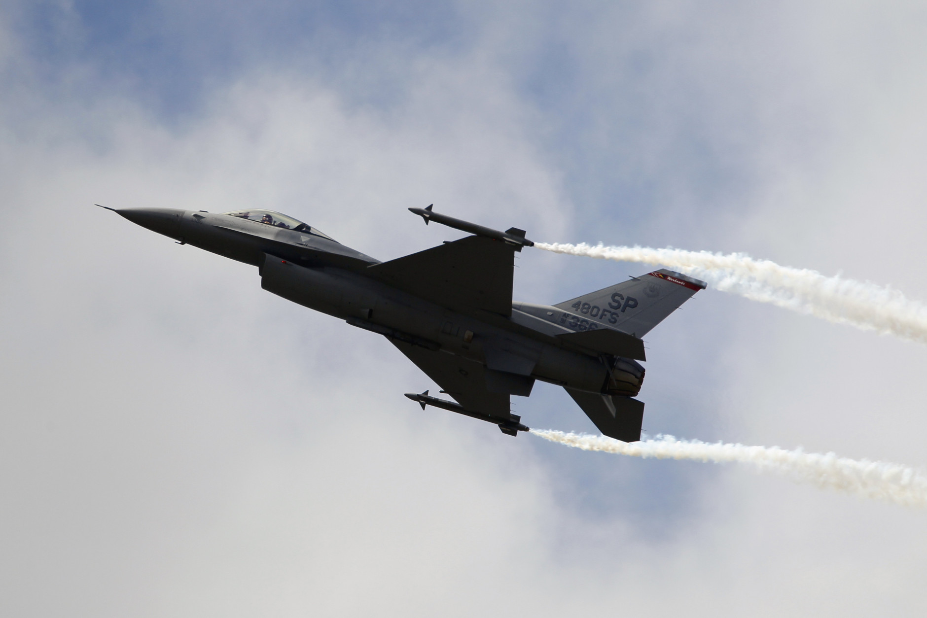 FILE - In this Wednesday June 22, 2011, file photo, a Lockheed Martin F-16 Jet fighter performs its demonstration flight at the 49th Paris Air Show at Le Bourget airport, east of Paris. Lockheed Martin is separating its information systems and global solutions unit, combining it with the engineering company Leidos so that it can focus on its remaining aerospace and defense business, the company announced Tuesday, Jan. 26, 2016. (AP Photo/Francois Mori, File)