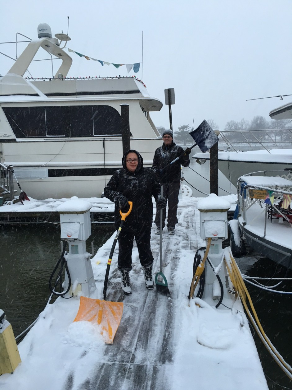 Melissa Ruiz and Tony Wetzler shovel snow on C Dock of the Gangplank Marina, where about 150 people live on their boats.(WTOP/Alan Etter)