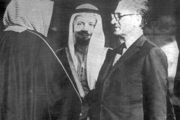 FILE - In this March 5, 1975 file photo, the Shah of Iran, right, meets with Prince Fahd, Vice Premier of Saudi Arabia and brother of King Faisal, left, and Sheikh Zaki Yamani, Saudi Arabian Oil Minister, center, in Algiers, Algeria at the villa where the Shah is staying during the O.P.E.C. summit. Under the rule of Shah Mohammad Reza Pahlavi, Iran had rocky relations with Saudi Arabia, though they improved toward the end of his reign. Both were original members of the oil cartel OPEC.(AP Photo, File)
