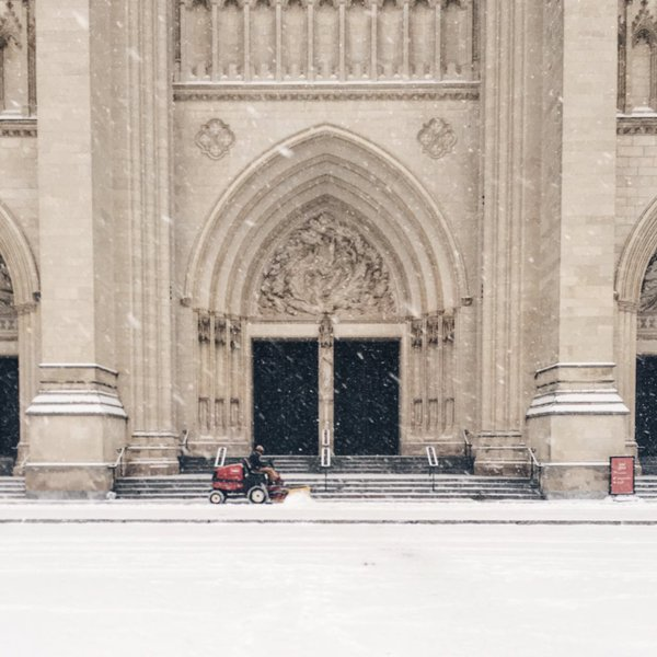 A worker removes snow from the steps of Washington National Cathedral on Friday, Jan. 22, 2016 (From Twitter user Jen Burnett)