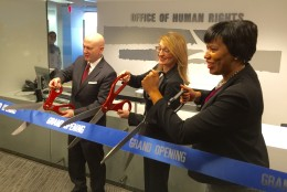 The D.C. Federal partnership in the Blue Campaign was announced at new offices for the city's Office of Human Rights.  XXXX and D.C. Office of Human Rights Director Monica Palacio join D.C. Mayor Muriel Bowers at the ribbon cutting.