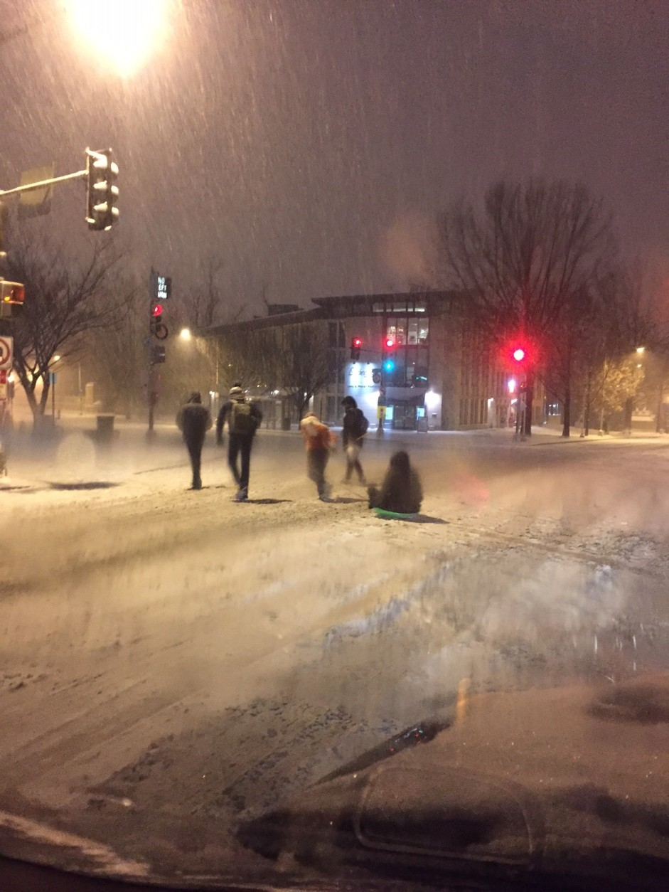 Sledders take advantage of the snow on Connecticut Avenue in Washington, D.C. on Friday, Jan. 22, 2016 (WTOP/Kyle Cooper)