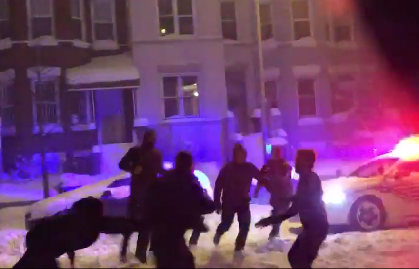 D.C. Police join in snow football game, deliver soul-crushing highlight
