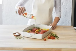 """Thrive, which sells for $11.99 for a 16.9 oz. bottle, has a high smoke point, making it easy to cook with at hot temperatures. Plus, Brooks says, it has a light flavor, which is ideal for salad dressings. """"It lets the flavors of food shine through,"""" he says."""