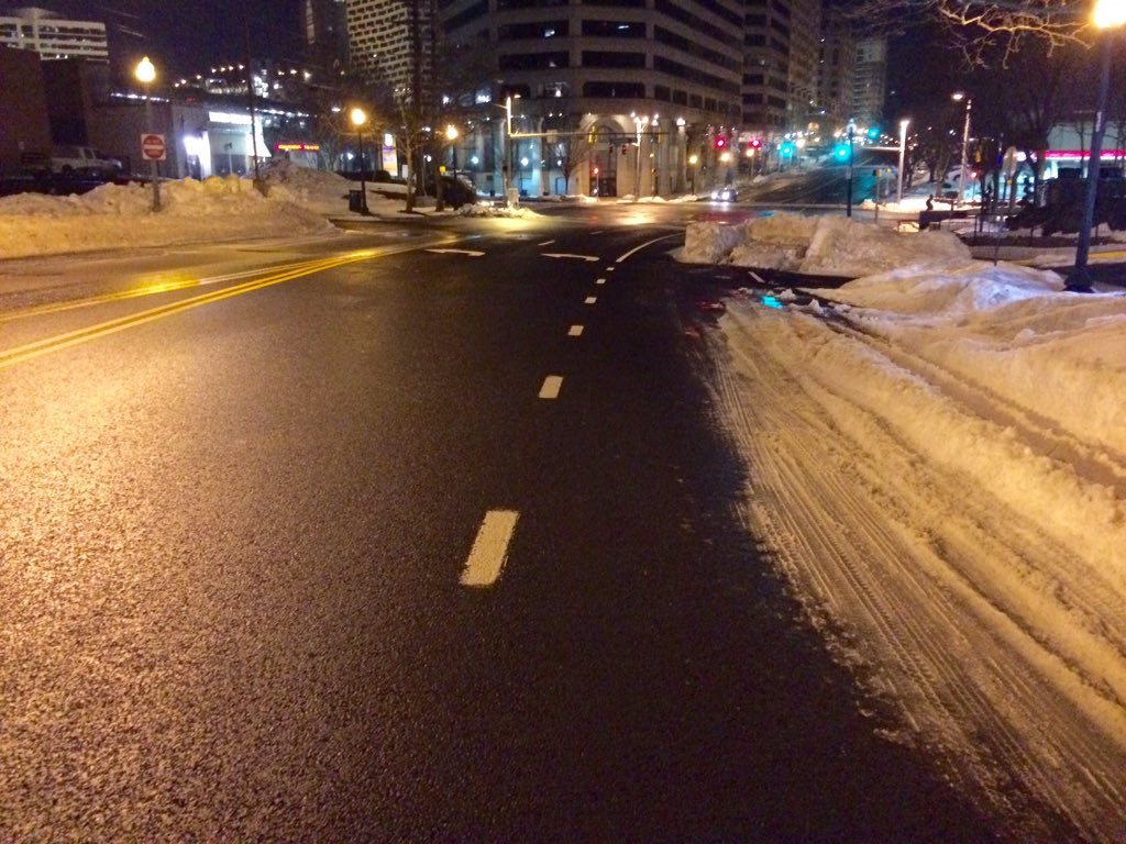 Snow is still taking up lanes on roads in the area, such as near the Silver Spring Transit Center. (WTOP/Nick Iannelli)