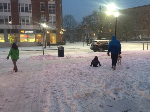 Residents of Northwest D.C. step out in the snow on Friday, Jan. 22, 2015. (WTOP/Max Smith)