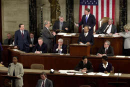 Rep. Cynthia McKinney, D-Ga., lower left, objects to Florida's electoral vote count results, as Vice President Al Gore, standing, top center, and House Speaker Dennis Hastert, R-Ill., seated, top right, listen on the floor of the U.S. House of Representatives, in Washington, Saturday, Jan. 6, 2001. Other members present, seated at left in middle row are: Sen. Mitch McConnell, R-Ky., Chris Dodd, D-Ct, hand over mouth., Chaka Fattah, D-Pa., standing at podium and Rep. William Thomas, R-Calif. Others not identified. Congress formally anointed George W. Bush on Saturday as the victor in last year's achingly close and bitterly contested presidential election. The Black Caucus walked out of the ceremony on Capitol Hill in protest of the results that gave the presidential election to Texas Gov. George W. Bush over Vice President Al Gore.  (AP Photo/Kenneth Lambert)