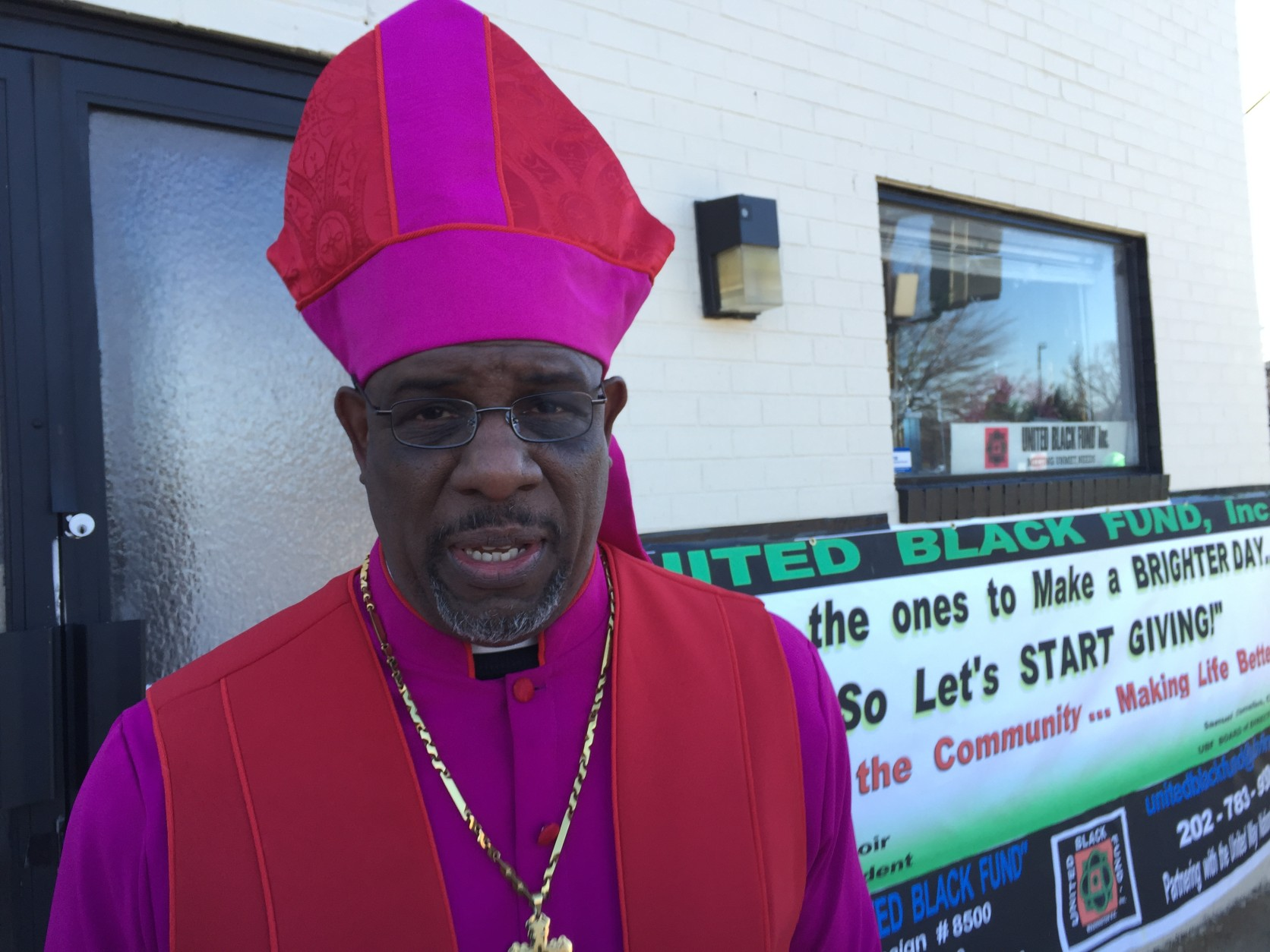"Bishop and Pastor of Greater Grace Family Ministries Church on Martin Luther King Jr. Ave, Doctor Edward Barnett believes the entire nation can come together as one community though peace. ""It's going to take peace, it's going to take love, it's going to take equality and freedom,""  Barnett said.  (WTOP/Kristi King)"