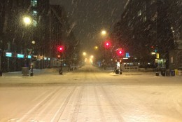 Inches of snow blanket the intersection of 19th and M Northwest in Washington, D.C. on Friday, Jan. 22, 2016. (From TWitter user reza mobayen)