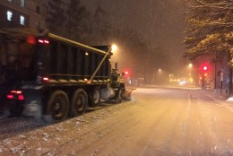 Snow plows roll down Connecticut Avenue near the National Zoo on Friday, Jan. 2016, as winter storm Jonas dumps massive amounts of snow in the region. (WTOP/Michelle Basch)