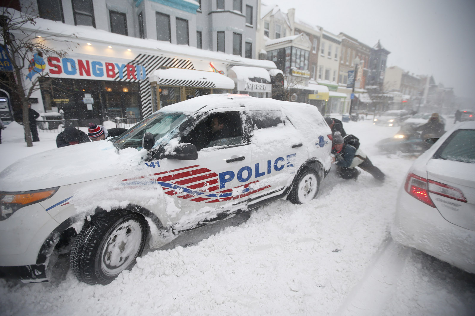 Police pitching in to clear snow from D.C. streets