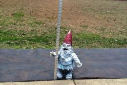 A garden gnome gets ready to measure the impending snow. (Courtesy Meg Casey)