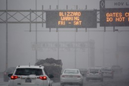 An overhead highway sign above Interstate 395 warns of impending blizzard conditions. (WTOP/Dave Dildine)