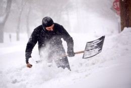 A man is seen in Northwest, D.C. digging out a path to a fire hydrant. (WTOP/Dave Dildine)