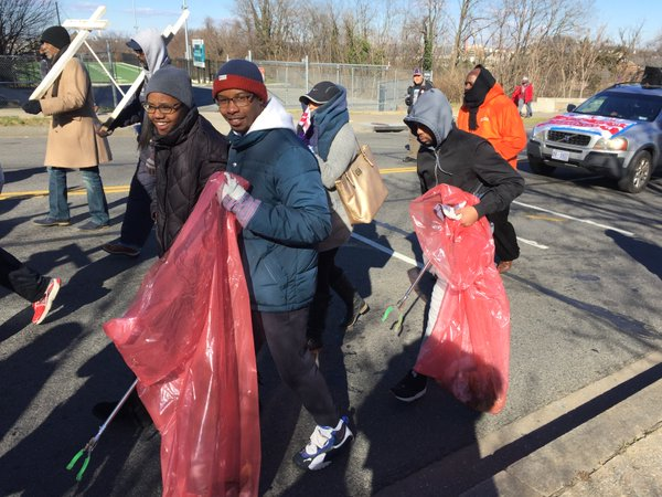"Barry Vettis is picking up trash during the MLK Peace Walk ""to help D.C. look beautiful."" (WTOP/Kristi King)"