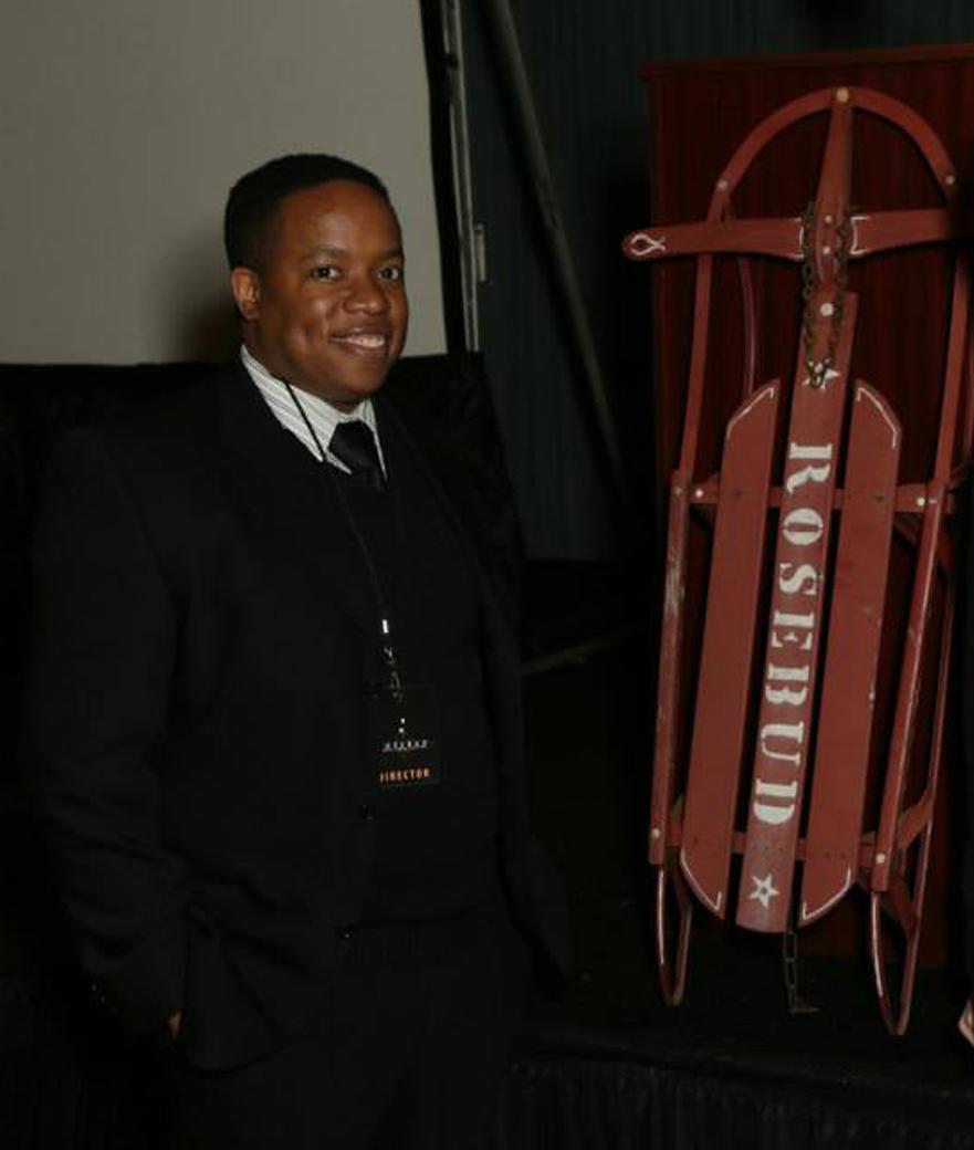 """Festival Director Kevin Sampson poses with the """"Rosebud"""" sled at the 2015 Rosebud Film Festival. (Courtesy Rosebud)"""