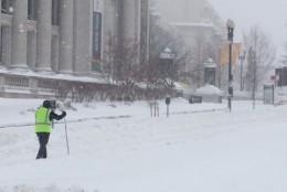 A man on skis is seen on Massachusetts Avenue in D.C. (WTOP/Steve Dresner)