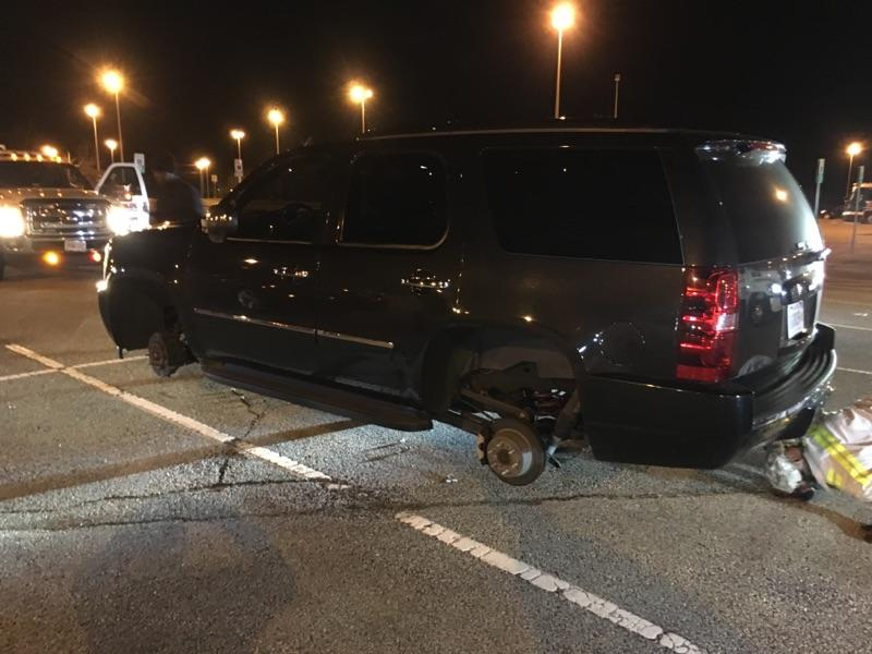 On March 10, Prince William County Police say thieves struck the Horner Road Commuter Lot once again. In this photo, an SUV is seen stripped of its' wheels and tires on Jan. 18. (Courtesy of Publix Towing)