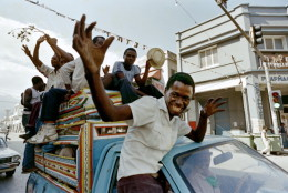 Anti-Duvalier Haitians celebrate in the streets of Port-au-Prince on February 07, 1986 after the announcement that President Jean-Claude Duvalier had fled the country. Dictator Jean-Claude Duvalier, alias Baby Doc, who replaced his father Francois Duvalier, Papa Doc, as life President in 1971, left Haiti for an exile in France on February 07, 1986 after a military junta took the power in the island. (Photo credit should read BOB PEARSON/AFP/Getty Images)