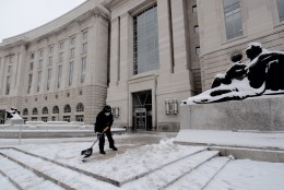 Crews at the Ronald Reagan Building and International Trade Center shovel after a 3-inch snowfall on Presidents Day, Monday, Feb. 15, 2016. (WTOP/Dave Dildine)