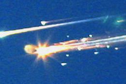 """In this Saturday, Feb. 1, 2003 file photo, debris from the space shuttle Columbia streaks across the sky over Tyler, Texas. A new NASA report says that the seat restraints, suits and helmets of the doomed crew of the space shuttle Columbia didn't work well, leading to """"lethal trauma"""" as the out-of-control ship broke apart, killing all seven astronauts. In a graphic 400-page report, NASA further studied the Feb. 1, 2003, shuttle tragedy to help them design their new shuttle replacement capsule more likely to survive an accident. (AP Photo/Dr. Scott Lieberman, File)"""