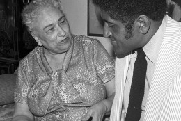 ** FILE ** Effa Manley, left, who co-owned the Newark Eagles of the Negro National League looks over a scrapbook with one of her former players, Don Newcombe, at her home in Los Angeles in this August 7, 1973 file photo.  Manley became the first woman elected to the baseball Hall of Fame among 17 people from the Negro Leagues and pre-Negro Leagues chosen Monday, Feb. 27, 2006 by a special committee. (AP Photo/File)