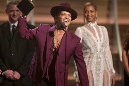 "Bruno Mars accept the award for record of the year for ""Uptown Funk"" at the 58th annual Grammy Awards on Monday, Feb. 15, 2016, in Los Angeles. (Photo by Matt Sayles/Invision/AP)"