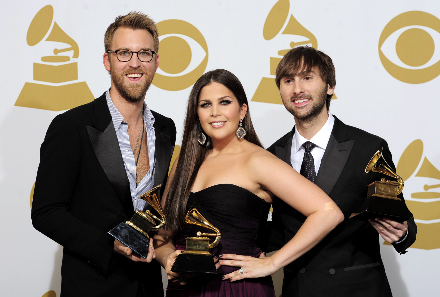 "From left, Charles Kelley, Hillary Scott and Dave Haywood, of musical group Lady Antebellum, pose backstage with the awards for best country album for ""Own the Night"" at the 54th annual Grammy Awards on Sunday, Feb. 12, 2012 in Los Angeles. (AP Photo/Mark J. Terrill)"