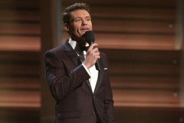 Ryan Seacrest introduces a performance by Little Big Town at the 58th annual Grammy Awards on Monday, Feb. 15, 2016, in Los Angeles. (Photo by Matt Sayles/Invision/AP)