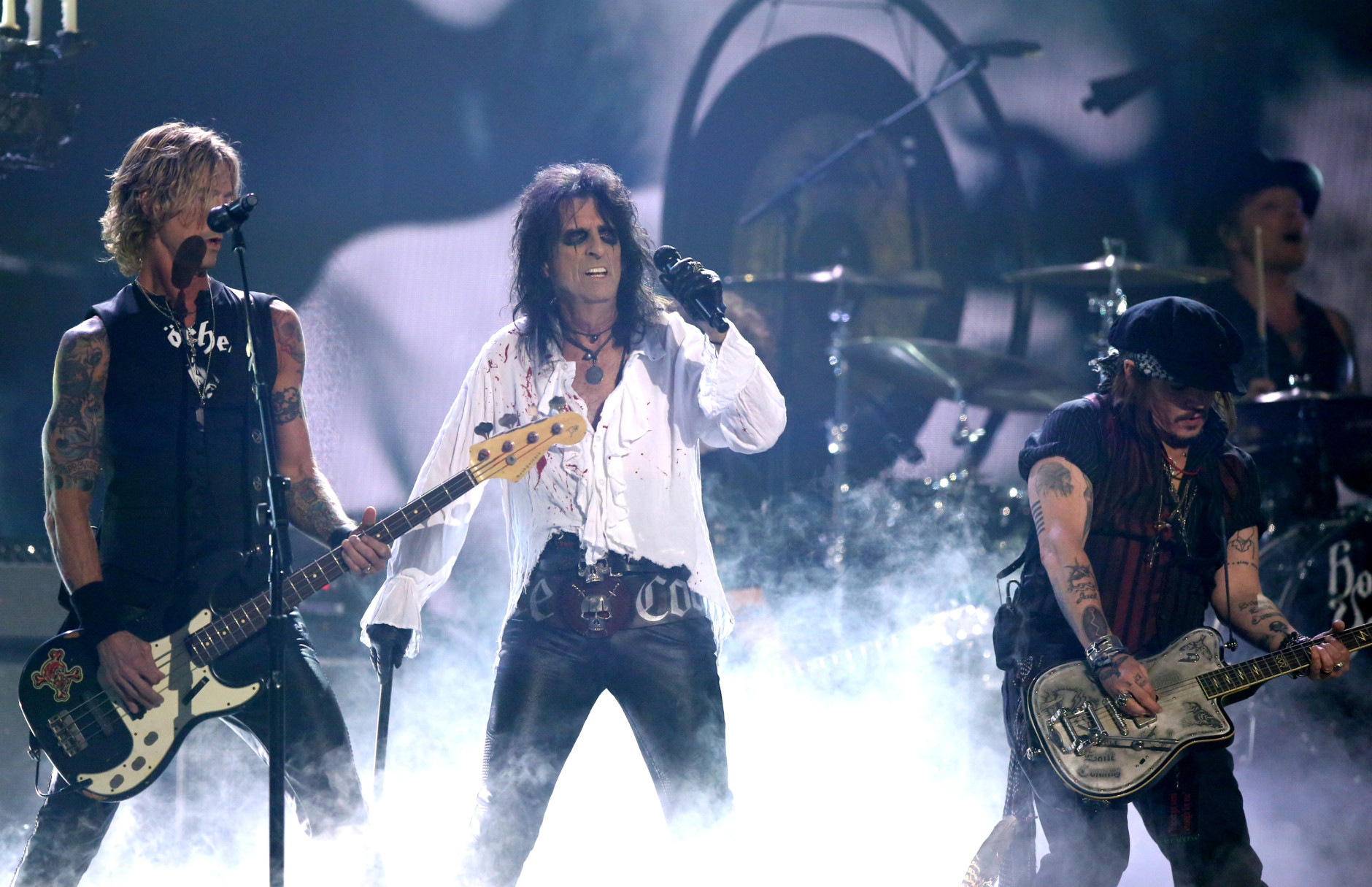 Duff McKagan, left, performs with Alice Cooper and Johnny Depp of Hollywood Vampires at the 58th annual Grammy Awards on Monday, Feb. 15, 2016, in Los Angeles. (Photo by Matt Sayles/Invision/AP)