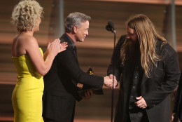 "Cam, left, and Gary Sinise present Chris Stapleton with the award for best country album for ""Traveller"" at the 58th annual Grammy Awards on Monday, Feb. 15, 2016, in Los Angeles. (Photo by Matt Sayles/Invision/AP)"