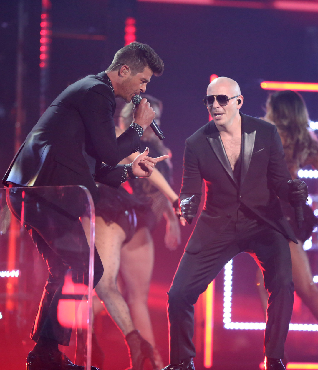 Robin Thicke, left, and Pitbull perform at the 58th annual Grammy Awards on Monday, Feb. 15, 2016, in Los Angeles. (Photo by Matt Sayles/Invision/AP)