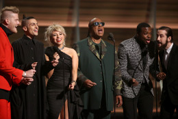 Stevie Wonder, center, and from left Scott Hoying, Mitch Grassing, Kristin Maldonado, Kevin Olusola, and Avi Kaplan of Pentatonix perform a tribute to Maurice White at the 58th annual Grammy Awards on Monday, Feb. 15, 2016, in Los Angeles. (Photo by Matt Sayles/Invision/AP)