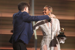 "Beyonce, right, presents Mark Ronson with the award for record of the year for ""Uptown Funk"" at the 58th annual Grammy Awards on Monday, Feb. 15, 2016, in Los Angeles. (Photo by Matt Sayles/Invision/AP)"