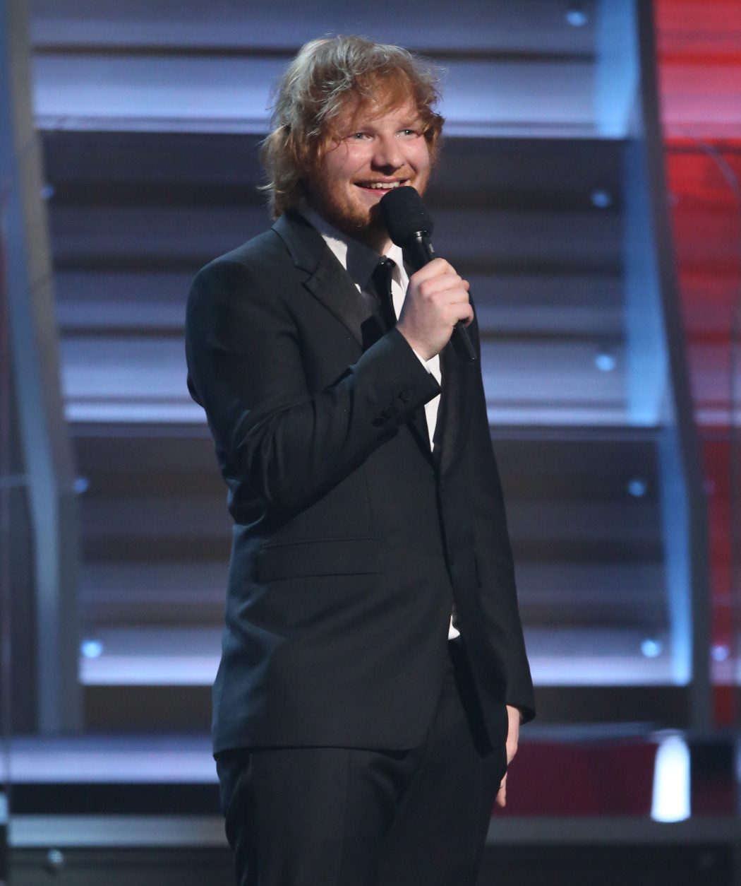 Ed Sheeran introduces a performance by Lady Gaga at the 58th annual Grammy Awards on Monday, Feb. 15, 2016, in Los Angeles. (Photo by Matt Sayles/Invision/AP)