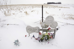 """FILE - In this Friday, Jan. 9, 2009 file photo, flowers adorn a memorial at the spot where the plane carrying Buddy Holly, Ritchie Valens and J.P. """"The Big Bopper"""" Richardson crashed killing all aboard on Feb. 3, 1959, near Clear Lake, Iowa. The three young singers were in a single-engine aircraft flying in a light snowstorm in 1959 when the pilot apparently lost control. Holly decided to fly because his tour bus was having heating problems. (AP Photo/Charlie Neibergall, File)"""