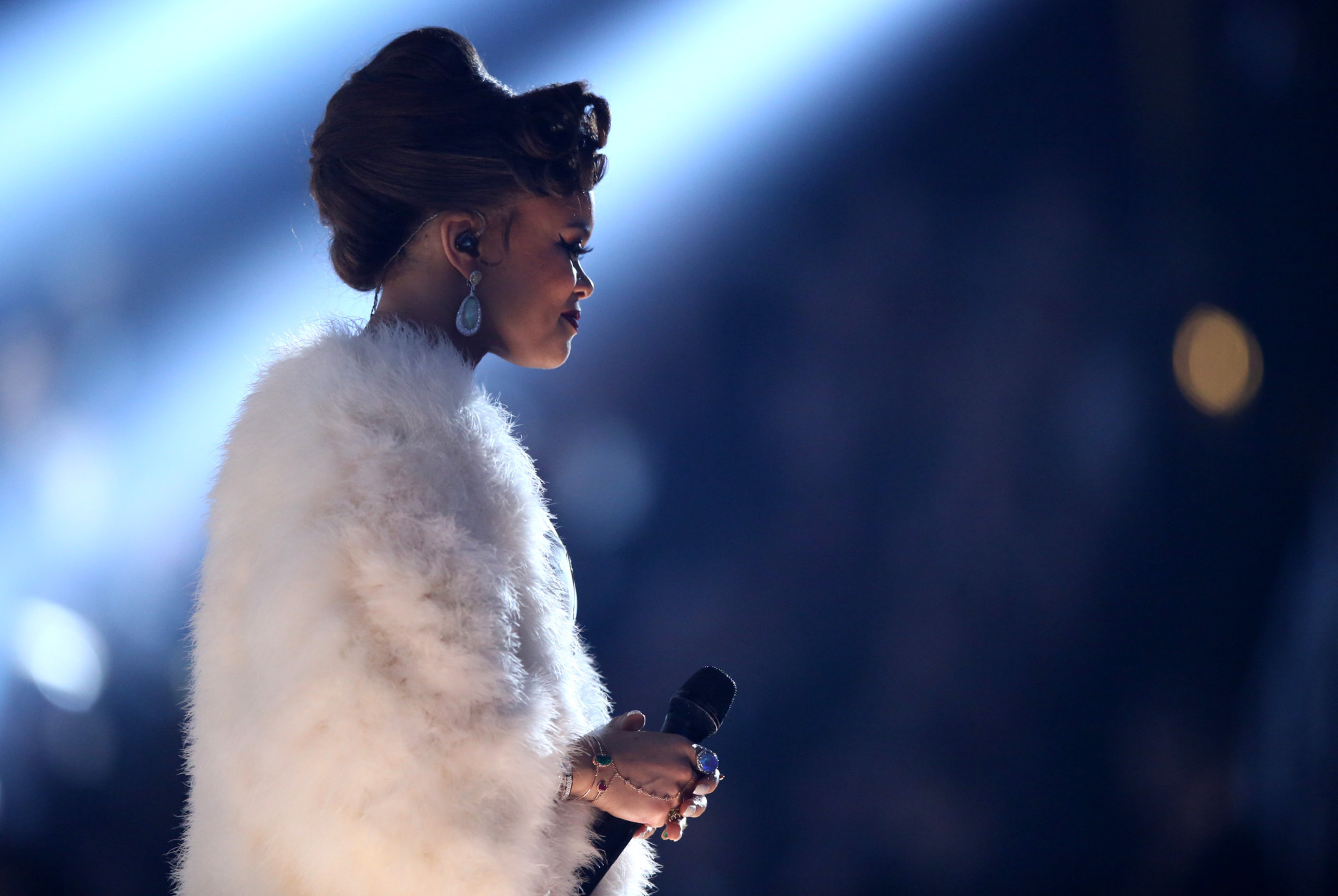 "Andra Day performs ""Rise Up"" at the 58th annual Grammy Awards on Monday, Feb. 15, 2016, in Los Angeles. (Photo by Matt Sayles/Invision/AP)"