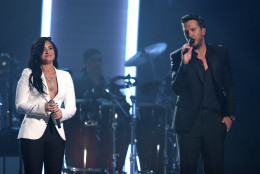 "Demi Lovato, left, and Luke Bryan perform ""Penny Lover"" for a tribute to MusiCares Person of the Year honoree Lionel Richie at the 58th annual Grammy Awards on Monday, Feb. 15, 2016, in Los Angeles. (Photo by Matt Sayles/Invision/AP)"