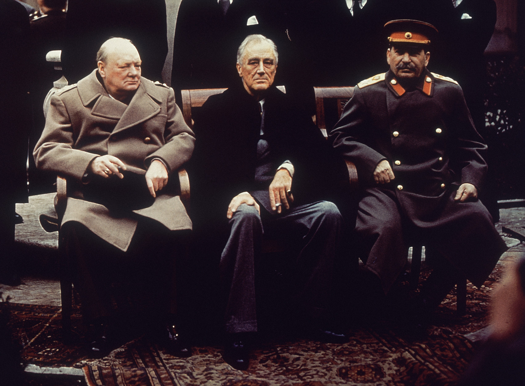 British Prime Minister Winston Churchill, U.S. President Franklin Roosevelt and Soviet Premier Josef Stalin sit on the patio of Livadia Palace, Yalta, Crimea, Feb. 4, 1945. (AP Photo)
