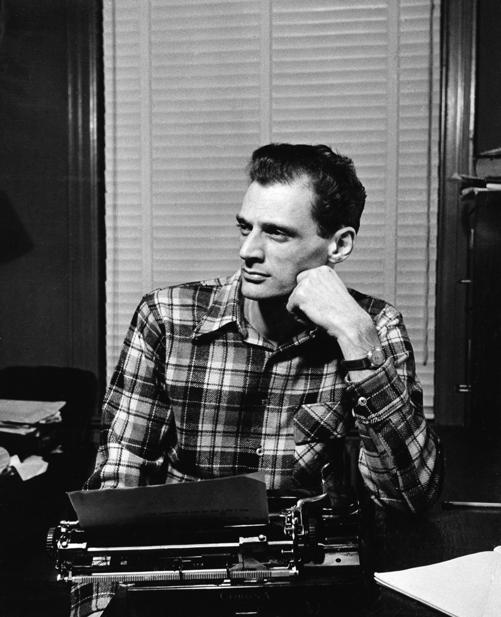 """Playwright Arthur Miller poses at his typewriter in New York City, May 2, 1949.  Miller is winner of the Pulitzer Prize for drama for his play """"Death of a Salesman.""""  (AP Photo)"""